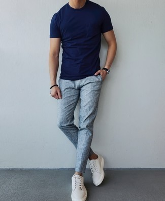 Navy Crew-neck T-shirt Outfits For Men: A navy crew-neck t-shirt and grey chinos worn together are a perfect match. If in doubt as to the footwear, add a pair of white canvas low top sneakers to the mix.