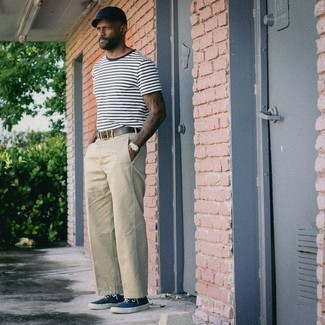 White and Navy Horizontal Striped Crew-neck T-shirt Outfits For Men: This combination of a white and navy horizontal striped crew-neck t-shirt and beige chinos is ideal for most casual settings. Throw in a pair of navy and white canvas low top sneakers and you're all done and looking boss.