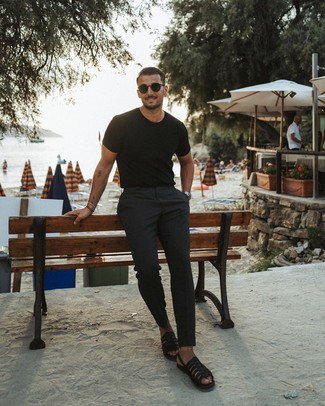 How to wear: black crew-neck t-shirt, black chinos, black leather sandals, black sunglasses