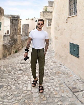 Men's Looks & Outfits: What To Wear In 2020: Dress in a white crew-neck t-shirt and olive chinos to feel invincible and look laid-back and cool. Add a pair of black leather sandals to your outfit to keep the getup fresh.