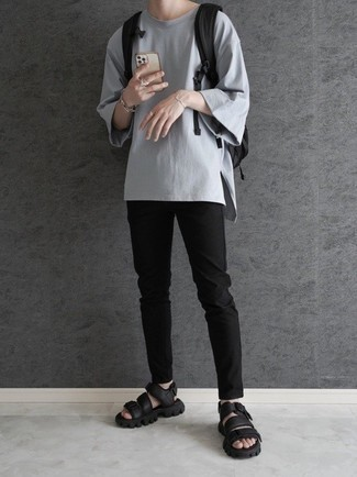 Black Canvas Backpack Outfits For Men: This urban pairing of a grey crew-neck t-shirt and a black canvas backpack is very easy to throw together in no time flat, helping you look awesome and ready for anything without spending too much time combing through your wardrobe. Finishing with a pair of black leather sandals is a fail-safe way to bring a sense of stylish casualness to your ensemble.