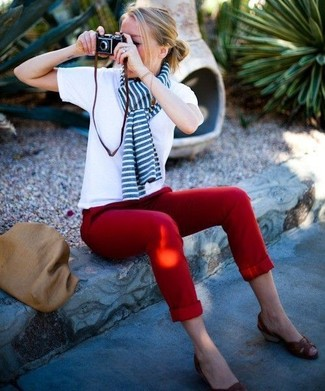 A white crew-neck tee and red chino pants is a smart combination to add to your casual repertoire. Dark brown leather wedge sandals will instantly smarten up even the laziest of looks.