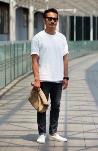 How to Wear Black Jeans In Hot Weather For Men: The go-to for a killer relaxed casual ensemble for men? A white crew-neck t-shirt with black jeans. To introduce a little flair to this getup, complete this ensemble with a pair of white leather slip-on sneakers.