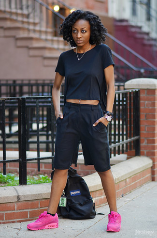 The versatility of a black crew-neck t-shirt and black culottes makes them investment-worthy pieces. Bring playfulness to your outfit with hot pink athletic shoes. You can bet this getup will become your uniform come summertime.