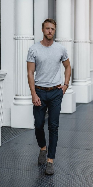 A grey crew-neck t-shirt and black dress pants are a great combo that will earn you the proper amount of attention. Balance this getup with charcoal suede derby shoes. Undoubtedly, you're looking at a wonderful choice for a hot weather afternoon.
