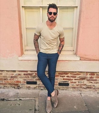 Wear a yellow crew-neck t-shirt with navy dress pants for your nine-to-five. Choose a pair of brown suede oxford shoes to show your sartorial savvy. You're sure to always look great even despite the sweltering heat if you have this outfit as your go-to formula.