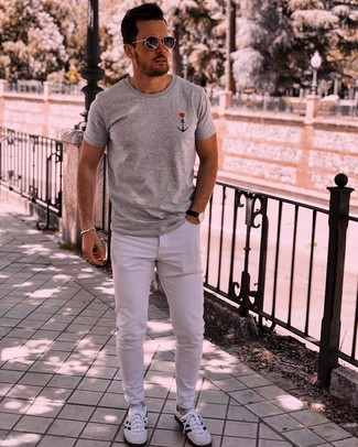 How to wear: grey print crew-neck t-shirt, white jeans, white and black athletic shoes, charcoal sunglasses