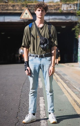 How to Wear a Blue Canvas Backpack For Men: This relaxed casual pairing of an olive crew-neck t-shirt and a blue canvas backpack is a lifesaver when you need to look great in a flash. Wondering how to finish off your look? Finish off with white athletic shoes to amp it up.
