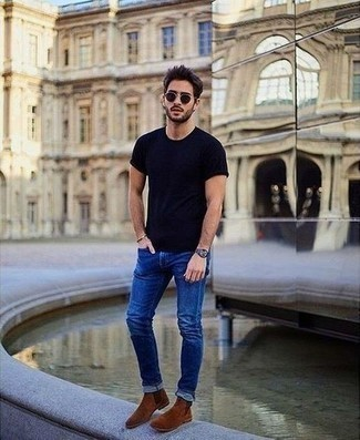 How to Wear Brown Suede Chelsea Boots For Men: This combination of a navy crew-neck t-shirt and blue jeans is well-executed and yet it looks laid-back and apt for anything. If you want to break out of the mold a little, throw a pair of brown suede chelsea boots into the mix.