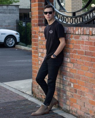 Black Jeans Outfits For Men In Their 20s: A black crew-neck t-shirt and black jeans paired together are a sartorial dream for gents who prefer laid-back and cool combos. For a more sophisticated spin, why not grab a pair of brown suede chelsea boots? If you're making it through your mid-20s, take cues from outfits like this to take a more mature approach to your style.