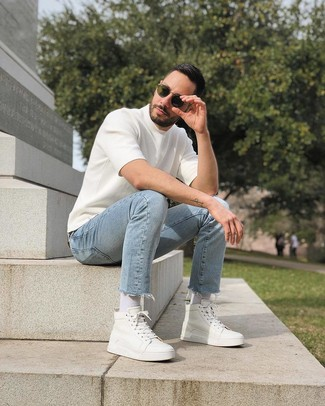 How to wear: white knit crew-neck t-shirt, light blue jeans, white leather high top sneakers, olive sunglasses