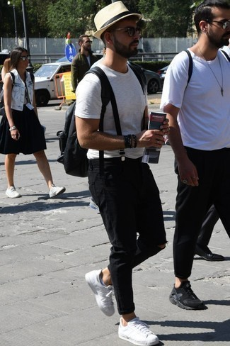How to Wear a Black Beaded Bracelet For Men: Choose a white crew-neck t-shirt and a black beaded bracelet for a relaxed take on casual urban menswear. Finish off your getup with a pair of white leather low top sneakers for a truly modern mix.