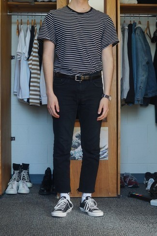 How to Wear Black Jeans For Men: You're looking at the hard proof that a black and white horizontal striped crew-neck t-shirt and black jeans look amazing when you pair them in an urban look. All you need is a cool pair of black and white canvas low top sneakers to complete this look.