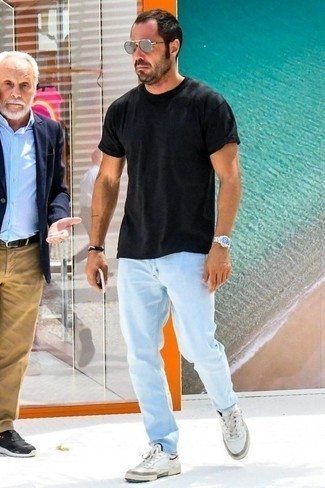 How to Wear a Black Bracelet For Men: This laid-back combo of a black crew-neck t-shirt and a black bracelet is a goofproof option when you need to look good but have zero time. Go the extra mile and shake up your outfit by slipping into white leather low top sneakers.