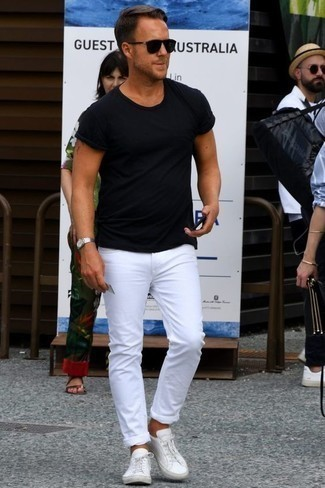 How to Wear White Leather Low Top Sneakers Casually For Men: This combination of a black crew-neck t-shirt and white jeans will allow you to display your expertise in men's fashion even on lazy days. If not sure about what to wear in the shoe department, complete your getup with a pair of white leather low top sneakers.