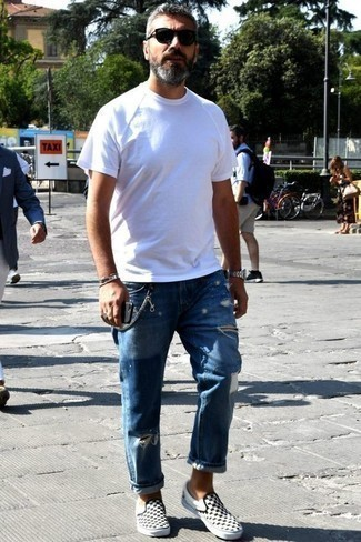 How to Wear Blue Ripped Jeans For Men: A white crew-neck t-shirt and blue ripped jeans are essential in any man's versatile casual closet. A pair of black and white check canvas low top sneakers easily dials up the style factor of any outfit.
