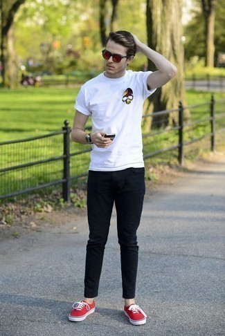 How to Wear a White Print Crew-neck T-shirt For Men: This casual combo of a white print crew-neck t-shirt and navy jeans is simple, stylish and super easy to imitate. Let your sartorial sensibilities truly shine by finishing your ensemble with a pair of red canvas low top sneakers.