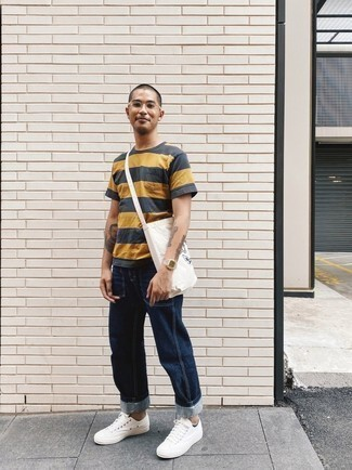 Gold Watch Outfits For Men: A charcoal horizontal striped crew-neck t-shirt looks so cool when matched with a gold watch. You can follow the classic route when it comes to footwear by wearing a pair of white canvas low top sneakers.