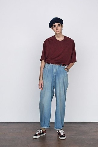 Light Blue Jeans Outfits For Men: Go for a simple but at the same time casually cool choice by teaming a burgundy crew-neck t-shirt and light blue jeans. A pair of black canvas low top sneakers looks amazing here.