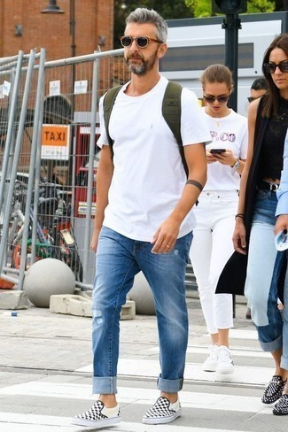 How to Wear Blue Ripped Jeans For Men: Wear a white crew-neck t-shirt with blue ripped jeans for both stylish and easy-to-wear ensemble. Black and white check canvas slip-on sneakers will infuse a dash of elegance into an otherwise everyday outfit.