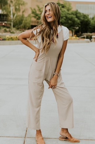How to wear: white crew-neck t-shirt, beige vertical striped jumpsuit, tan leather mules, red print bandana