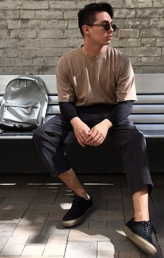 How to Wear a Black Long Sleeve T-Shirt For Men: Extra dapper and practical, this relaxed casual combination of a black long sleeve t-shirt and black chinos will provide you with variety. Let your sartorial credentials really shine by rounding off your getup with black canvas low top sneakers.