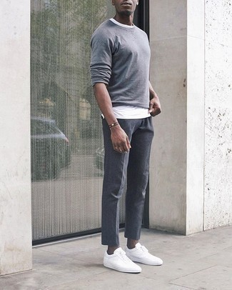 Dark Brown Bracelet Casual Outfits For Men: Dress in a grey long sleeve t-shirt and a dark brown bracelet to feel 100% confident in yourself and look on-trend. Introduce white canvas low top sneakers to the mix for an extra dose of polish.