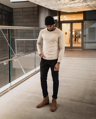 Beige Long Sleeve T-Shirt Outfits For Men: One of the coolest ways for a man to style a beige long sleeve t-shirt is to team it with black jeans in a casual combo. And if you need to easily perk up your ensemble with footwear, complement this look with a pair of brown suede chelsea boots.