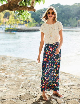 Consider teaming a white polka dot crew-neck tee with a navy floral maxi skirt for an easy to wear look. A good pair of khaki leather thong sandals are sure to leave the kind of impression you want to give.