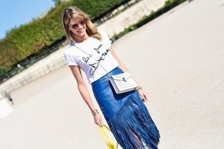 Blue Leather Skirt Outfits: If it's ease and practicality that you love in an ensemble, wear a white and black print crew-neck t-shirt with a blue leather skirt.