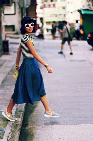 Look awesome without trying too much in a white and black striped crew-neck tee and a navy blue denim midi skirt. For a more relaxed take, go for a pair of baby blue low top sneakers. Is there a better choice for a warm summer afternoon?