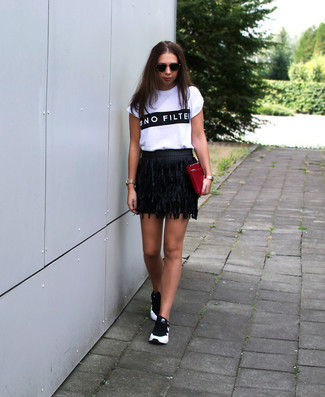 How to wear: white and black print crew-neck t-shirt, black fringe leather mini skirt, black and white athletic shoes, burgundy leather clutch