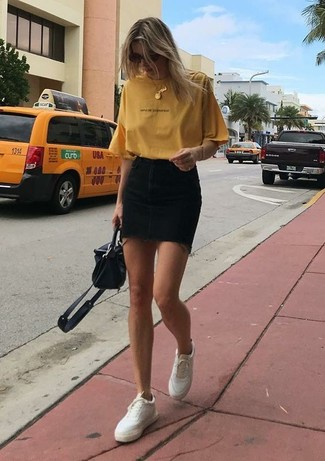 How to wear: yellow crew-neck t-shirt, black denim mini skirt, white leather low top sneakers, black leather crossbody bag