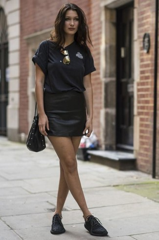 Wear a black crew-neck t-shirt and a black leather mini skirt for a relaxed take on day-to-day wear. As for the shoes, go down the classic route with black leather oxfords. We can't get enough of this combo for roasting hot summertime afternoons.