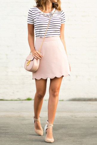 How to wear: white and black horizontal striped crew-neck t-shirt, pink mini skirt, beige suede pumps, pink leather crossbody bag