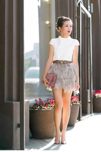 Team a white crew-neck tee with a beige fluffy mini skirt for an easy to wear look. As for the shoes, go down the classic route with beige leather pumps. You know when it's super hot outside, sometimes only a cool outfit like this one can get you through the day.