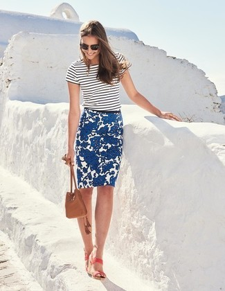 How to wear: white and black horizontal striped crew-neck t-shirt, blue floral pencil skirt, pink leather heeled sandals, brown leather bucket bag