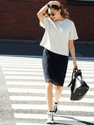 How to wear: grey crew-neck t-shirt, black lace pencil skirt, black and white canvas high top sneakers, black leather tote bag