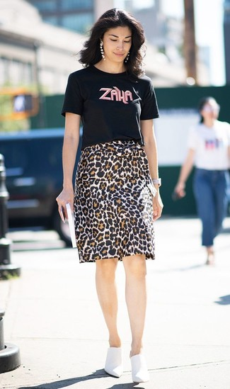How to wear: black print crew-neck t-shirt, brown leopard pencil skirt, white leather mules, white leather watch