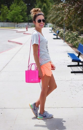 How to wear: grey print crew-neck t-shirt, orange shorts, grey athletic shoes, hot pink leather crossbody bag