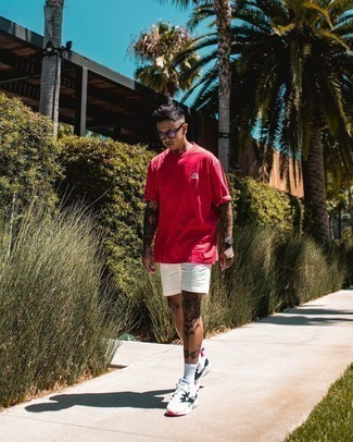 White Shorts Outfits For Men: Uber stylish and comfortable, this casual pairing of a red crew-neck t-shirt and white shorts provides with amazing styling possibilities. When this outfit is too much, play it down by rocking white and black athletic shoes.