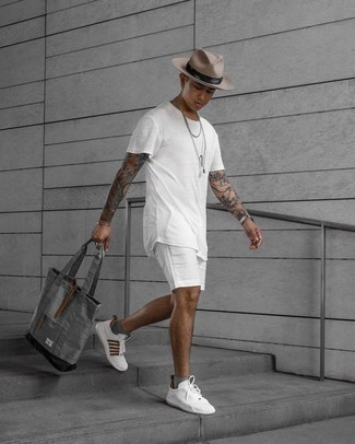 White Shorts Outfits For Men: Go for a simple but casual and cool outfit by wearing a white crew-neck t-shirt and white shorts. Send an otherwise dressy look in a whole other direction by wearing a pair of white and red athletic shoes.