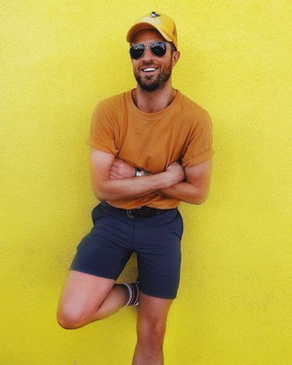 How to wear: orange crew-neck t-shirt, navy shorts, yellow baseball cap, black leather belt