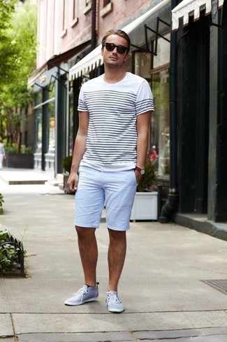 How to Wear a Navy Horizontal Striped Canvas Watch For Men: Beyond stylish, this combo of a white and navy horizontal striped crew-neck t-shirt and a navy horizontal striped canvas watch will provide you with variety. In the shoe department, go for something on the smarter end of the spectrum by sporting a pair of light blue canvas desert boots.