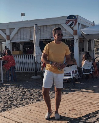White Shorts Casual Outfits For Men: To achieve a relaxed look with a fashionable spin, wear an orange crew-neck t-shirt and white shorts. Follow the classic route on the shoe front by slipping into grey canvas espadrilles.