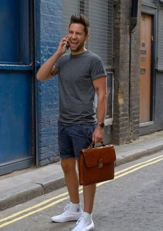 How to wear: charcoal crew-neck t-shirt, navy shorts, white canvas high top sneakers, brown leather briefcase