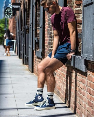 How to wear: burgundy crew-neck t-shirt, navy shorts, navy canvas high top sneakers, black sunglasses