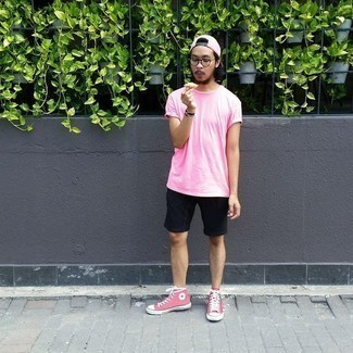 How to Wear a Pink Baseball Cap For Men: Try pairing a pink crew-neck t-shirt with a pink baseball cap, if you feel like comfort dressing without looking like you don't care to look stylish. Complement this outfit with a pair of pink canvas high top sneakers for a touch of refinement.