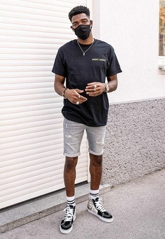 How to Wear a Dark Brown Beaded Bracelet For Men: You'll be surprised at how extremely easy it is for any gentleman to get dressed this way. Just a black print crew-neck t-shirt and a dark brown beaded bracelet. If you wish to easily amp up this getup with one piece, add black and white print canvas high top sneakers to the equation.