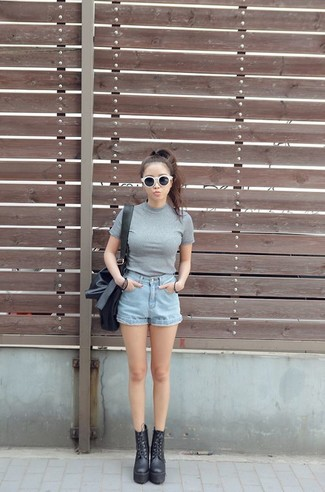A grey crew-neck tee and baby blue denim shorts are both versatile essentials that will give your outfits a subtle modification. Add black chunky leather lace-up ankle boots to your look for an instant style upgrade.